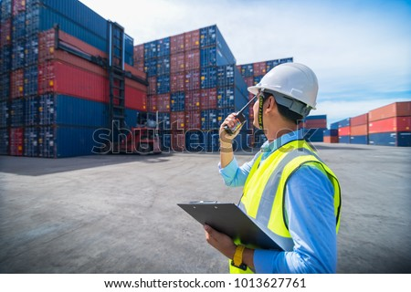 Foreman control loading containers box from cargo freight ship for import export, Foreman control industrial container cargo freight ship, Business logistic concept, Import and export concept