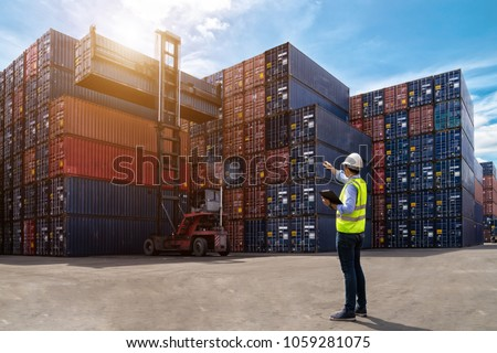 Foreman control loading Containers box from Cargo freight ship for import export, foreman control Industrial Container Cargo freight ship