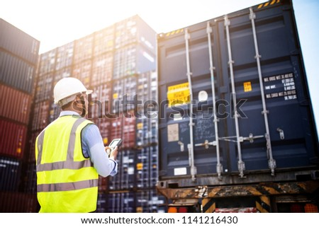 Foreman control loading Containers box from Cargo freight ship for import export, foreman control Industrial Container Cargo freight ship. Logistic concept.