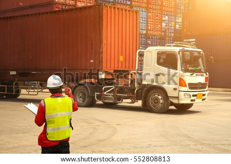 Foreman control loading Containers box to truck for Logistic Import Export Background, Business logistic concept