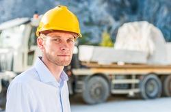 Foreman near a truck
