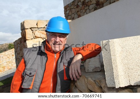 Foreman standing in front of house under construction