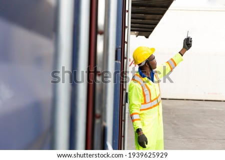 Foreman using mobile phone and laptop in the port of loading goods. Foreman on Forklifts in the Industrial Container Cargo freight ship. Zdjęcia stock ©