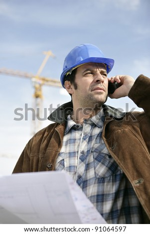 Foreman with a laptop and phone