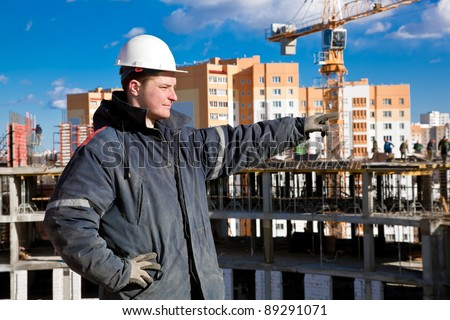 Foreman worker giving instructions to construction workers at building site