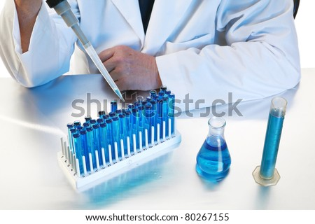 forensic analysis, science, medical, chemistry - a chemist works in his laboratory with various chemicals to document various reactions and interactions. Isolated on white with room for your text.