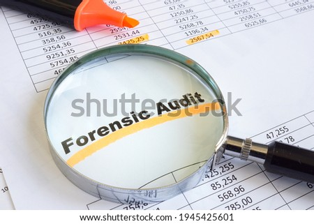 Forensic audit data and magnifying glass on papers. Stock photo ©