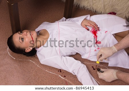 Forensic expert collecting evidence in a crime scene (imitation)