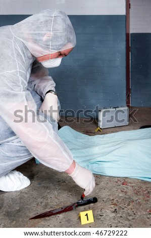 stock photo : Forensic expert dusting for fingerprints on knife - the murder
