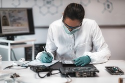 Forensic Science Investigator Examining Computer Hard Drive. Digital Forensic Science Concept.