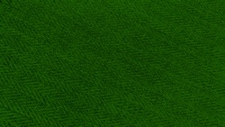 forest green color texture of the herringbone pattern fabric. trendy green color knit fabric with geometric patterns of wool and cotton.