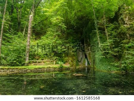 Forest lake in the Szalajka valley (Szalajka-völgy) with a mirroring view of the surroundings and a small waterfall, Beech Mountains (Bükk hegység), Hungary Stock fotó ©