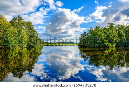 Forest lake water reflection sky clouds. Lake water reflection. Lake in forest. Lake reflection sky clouds