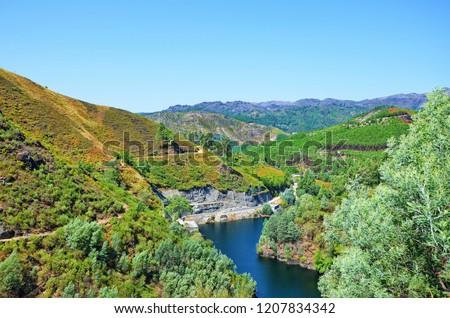 Forest landscape around the Rabagao River towards to the Venda Nova Dam in Peneda-Geres National Park, northern Portugal. Venda Nova Dam is a hydroelectric power station. Photo: September 1st 2018