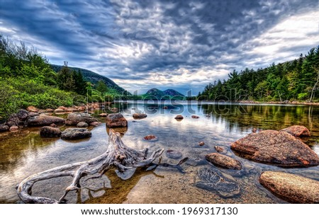 Forest river on a gloomy day. River rocks view. Rocks in forest river. Forest river landscape