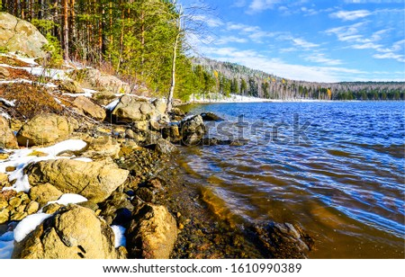 Forest river shore rocks scene. Karelia forest river rocks view. Forest rocky beach river scene. River water in forest