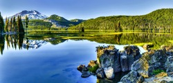 Forest river water reflection panorama. Panorama of mountain lake. Mountain lake water. Mountain lake view