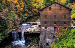 Forest river waterfall house view. Forest river house. Autumn forest river house. House in deep autumn forest
