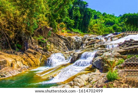 Forest river waterfall in mountains. River stream waterfall in mountain forest. Mountain forest river waterfall view