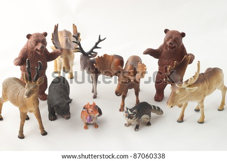 Forest themed toys facing front against a white background