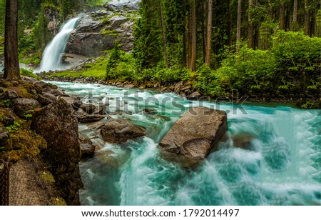 Photo of  Forest waterfall river stream view. River wild in forest. Forest river rapid. River rock water
