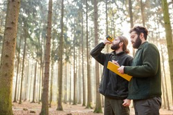 Forester determine tree height by three-point measurement with rangefinder in the forest