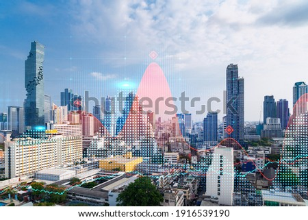 Forex and stock market chart hologram over panorama city view of Bangkok, the financial center in Asia. The concept of international trading. Double exposure. ストックフォト ©