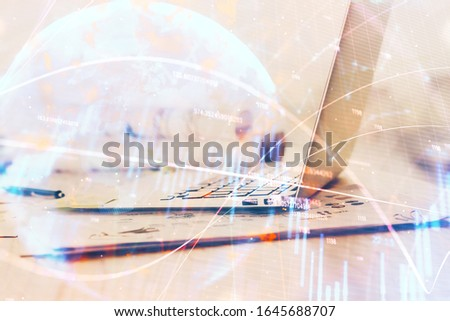 Forex Chart hologram on table with computer background. Double exposure. Concept of financial markets.