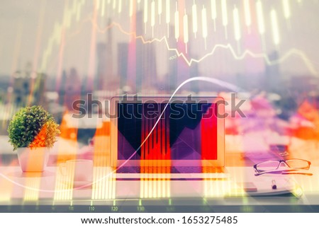 Forex Chart hologram on table with computer background. Multi exposure. Concept of financial markets.