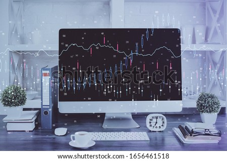 Forex graph hologram on table with computer background. Double exposure. Concept of financial markets.