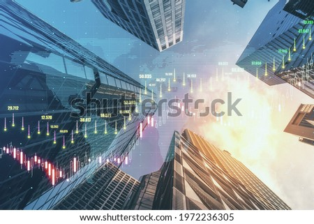 Forex trade market and development concept with growing digital candlestick and indicators on sunny skyscrapers background. Double exposure