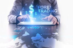 Forex trading concept. Businessman using futuristic tablet computer, pressing button on the touch screen and selecting dollar icon with FOREX TRADING text.