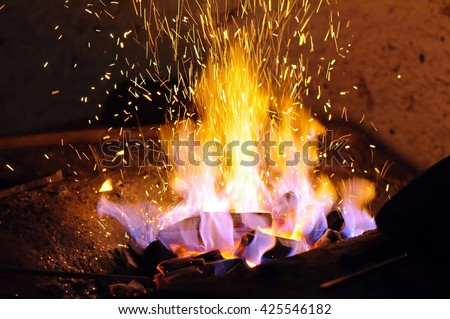 Forge fire Forge fire used for creating iron tools in blacksmith\'s.