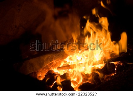 forge fire in blacksmith\'s where iron tools are crafted