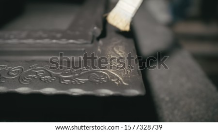 Forge workshop. Smithy manual production. The product is artificially aged. Gold powder painting of scratches, roughness and scuffs. Ageing. Aging processes. Pattern on iron. Carving ornament. #1577328739