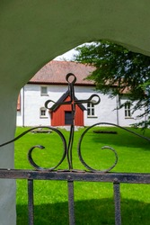 Forged cross on a gate