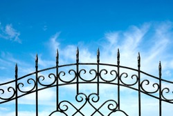 forged metal fence against the sky