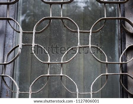 forged metal figured lattices on the windows, unusual shape, pre-revolutionary