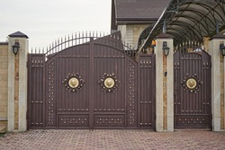 Forged metal gates with ornate lines in a private house.