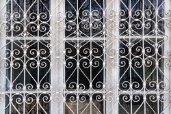 Forged metal protective grille on an old window