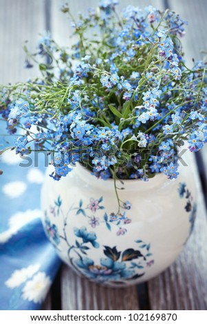 Forget-me-not flowers on a wooden table