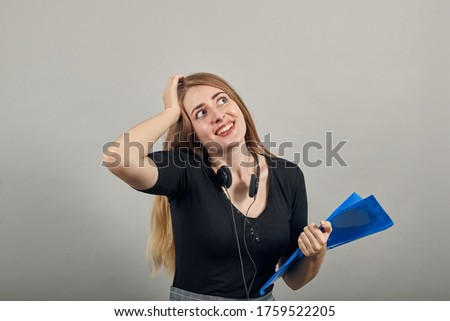 Forgetful holding hand to hair, touches head forgot something important regrets about mistake feels stressed, bad memory absent-mindedness. Blue office folder documents in hand. Attractive woman Stock photo ©