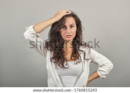 Forgetful holding hand to hair, touches head forgot something important regrets about mistake feels stressed, bad memory absent-mindedness, facepalm disappointed, slapping forehead, oversight Stock photo ©