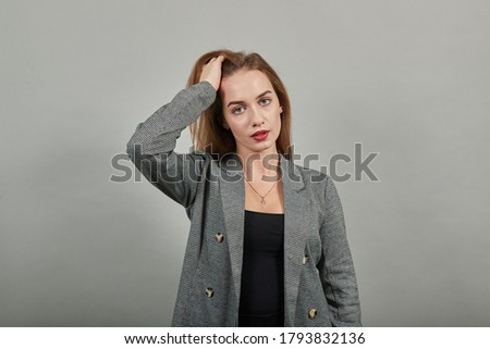Forgetful holding hand to hair, touches head forgot something important regrets about mistake feels stressed, bad memory absent-mindedness, facepalm disappointed, slapping forehead. Attractive woman Stock photo ©