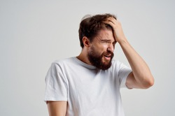 forgetfulness man touches his head with his hand scatteredness absent-mindedness