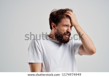 forgetfulness man touches his head with his hand scatteredness absent-mindedness                            Stock photo ©