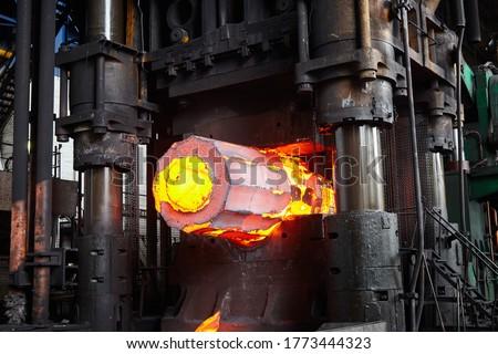 Forging a workpiece on a forging press. Forging production. Stock fotó ©