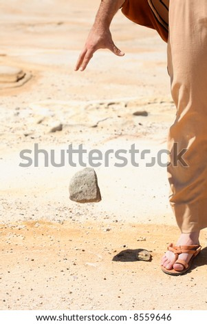 Forgiveness - its all in my hands.  Symbolic concept of man dropping a stone from his hand.   Concept, peace, mercy, pardon, forgiveness, compassion.