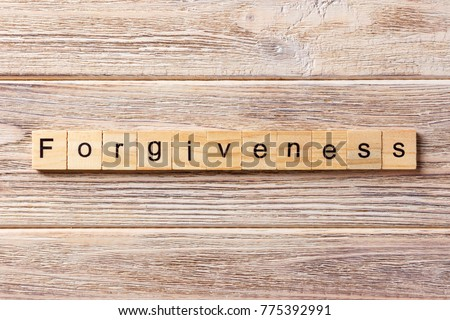 forgiveness word written on wood block. forgiveness text on table, concept. Stock photo ©