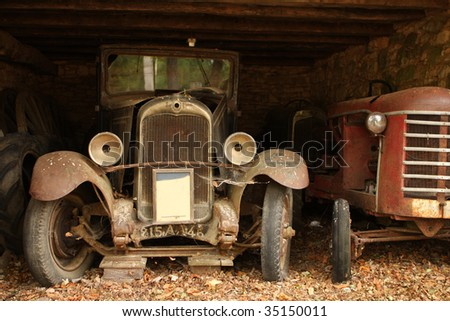 Forgotten old vintage cars in barn, dordogne, france.